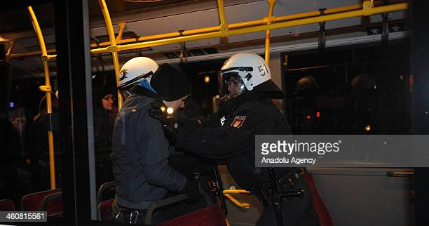 German police takes into custody the protestors shouting slogans in ''Danger Zone'' declared Altona Sankt Pauli Sternschanze of Hamburg on January...