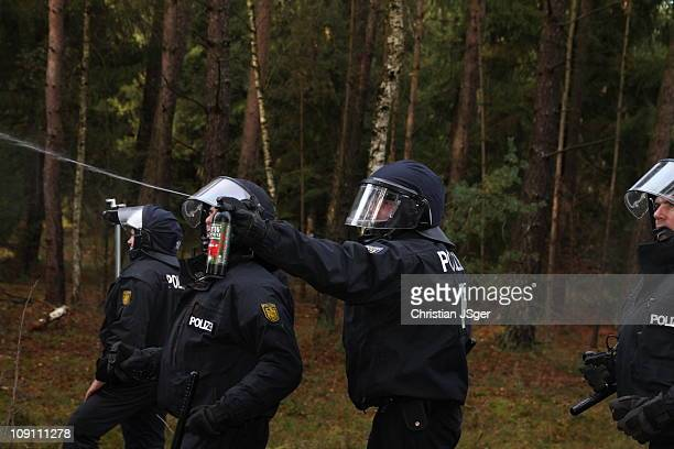 German police use pepper spray to fight against people they want to 'schottern' against the Castortransport
