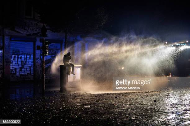 German police using water cannons and tear gas against anticapitalist demonstrators during riots on July 9 2017 in Hamburg northern Germany German...