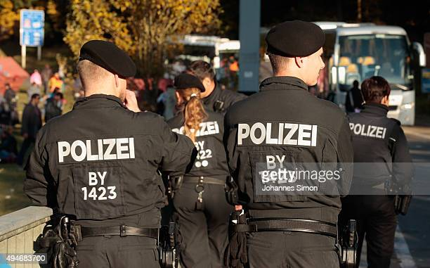 German police watch migrants arriving at the border to Austria on October 28 2015 near Wegscheid Germany Bavarian Governor Horst Seehofer has accused...