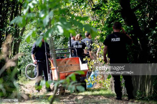 German police work during a search in a garden allotment in the northern German city of Hanover on July 29 in connection with the disappearance of...