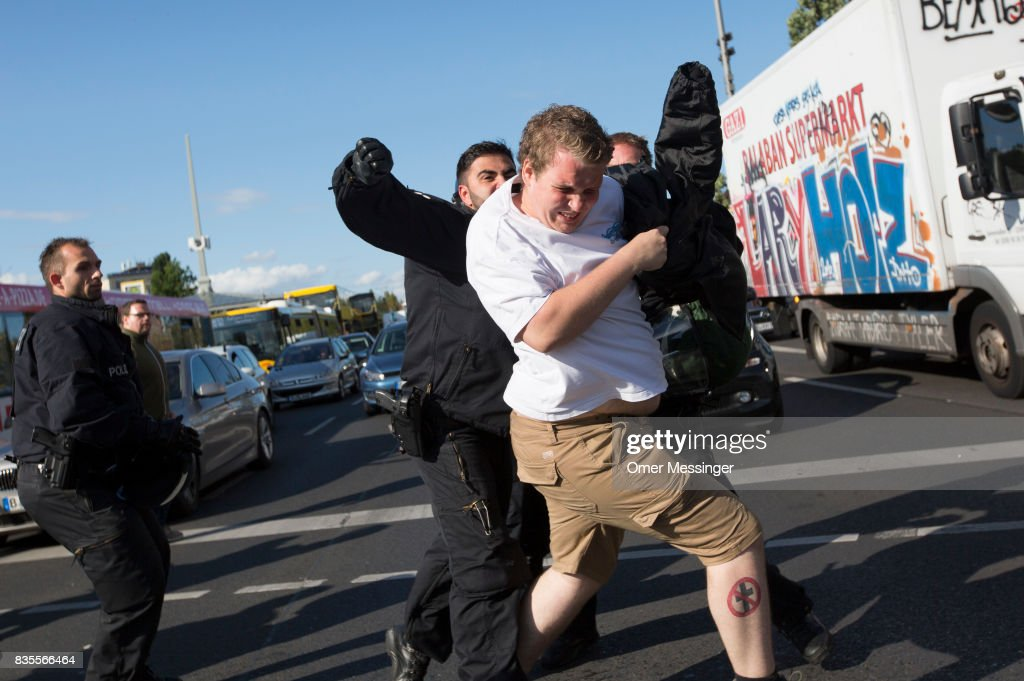 German policeman arrest a participant of a Neo-Nazi march, after a fight that broke out with fascists in the end of the march as the two sides were dispersing, on August 19, 2017 in Berlin, Germany. Some 1000 participants affiliated with Neo-Nazi and extreme right groups marched through the street of Berlin's Spandau district in commemoration of 30 years to Rudolf Hess's death. Hess committed suicide on August 17, 1987 at Spandau Prison and he also served as Adolf Hitler's deputy. The march attracted counter demonstrations along its route, organized by several left-wing groups and political parties.