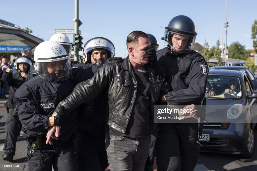 German policeman arrest a participant of a Neo-Nazi march after a fight that broke out at the end of the march as people were dispersing, on August 19, 2017 in Berlin, Germany. Some 1000 participants affiliated with Neo-Nazi and extreme right groups marched through the street of Berlin's Spandau district in commemoration of 30 years to Rudolf Hess's death. Hess committed suicide on August 17, 1987 at Spandau Prison and he also served as Adolf Hitler's deputy. The march attracted counter demonstrations along its route, organized by several left-wing groups and political parties.