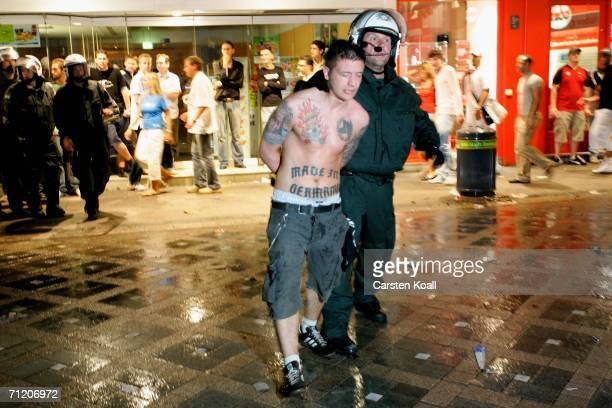 German policeman arrests a soccer fan during clashes after the FIFA World Cup Germany 2006 Group A match between Germany and Poland on June 14 2006...