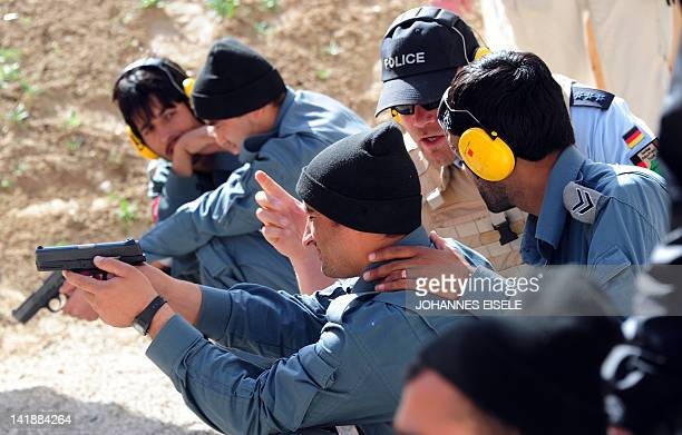 A German policeman talks to ANP trainees at the PTC shooting range of the German Police Project Team next to Camp Marmal the Bundeswehr base in...