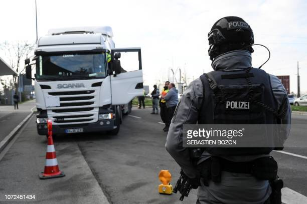 German policemen control motorists at the Franco-German border in Kehl, on December 13 as part of the hunt for the gunman who killed three people and...
