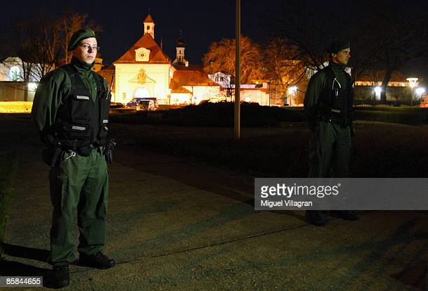 German policemen stand guard in front of the entrance of the local prison April 7, 2009 in Straubing, Germany. A 51-year-old prisoner took a female...