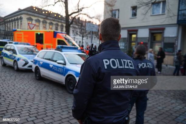 German policemen stand guard on a steet on December 1 2017 after a suspicious object prompted the evacuation of a Christmas market in Potsdam...