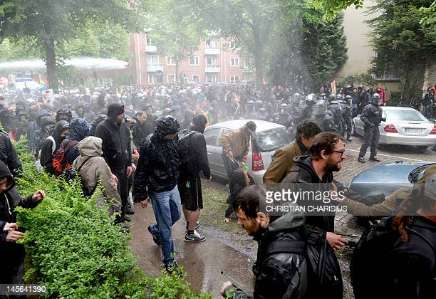 """German policemen try to clear a blockade during a rally against a """"Day of German Future"""" demonstration of farright extremists in Hamburg, northern..."""