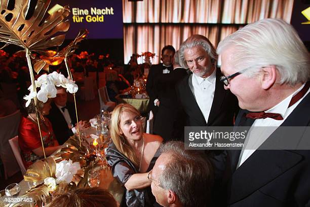 German politican FrankWalter Steinmeier talks to Nastassja Kinski during the 2012 Sports Gala 'Ball des Sports' at the RheinMain Hall on February 4...