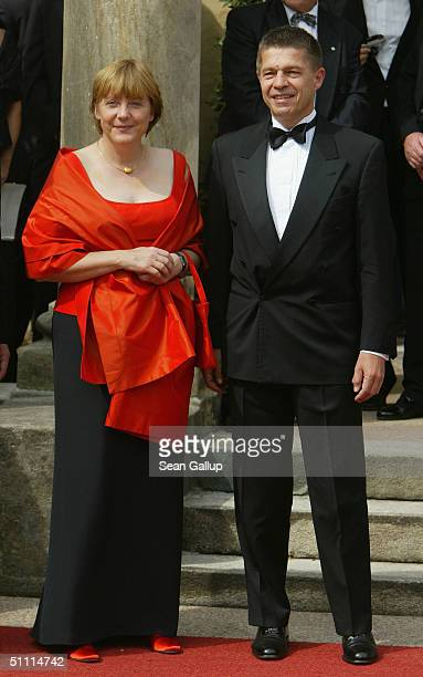 German politician Angela Merkel and her husband Joachim Sauer arrive for the opening performance of Richard Wagner's 'Parsifal' July 25 2004 on the...
