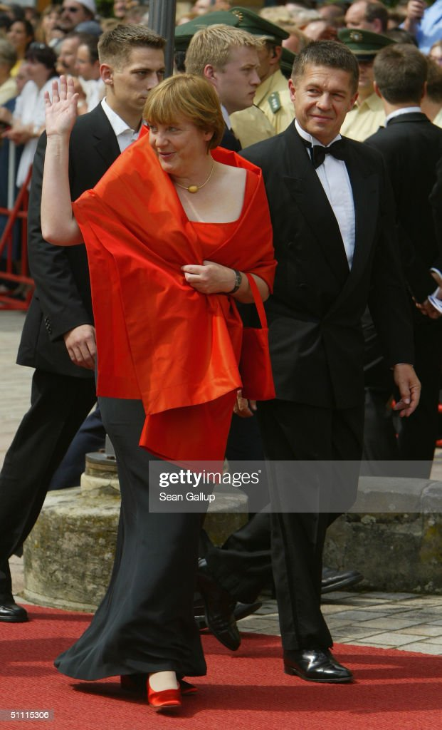 German politician Angela Merkel and her husband Joachim Sauer arrive for the opening performance of Richard Wagner's 'Parsifal' July 25, 2004 on the first day of the 93rd Richard Wagner Festival in Bayreuth, Germany.