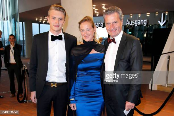 German politician Guenther Oettinger with his partner Friederike Beyer and his son Alexander Oettinger attend the 'Deutscher Radiopreis' at...