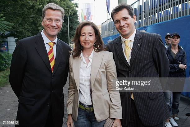 German politician Guido Westerwelle singer Vicky Leandros and Westerwelle's partner Michael Mronz pose for a photograph after attending a promotional...