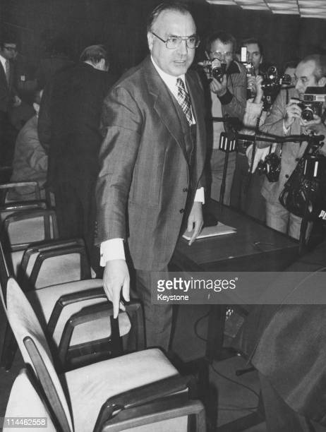 German politician Helmut Kohl chairman of the Christian Democratic Union leaving a conference hall after a meeting of the executive board of his...