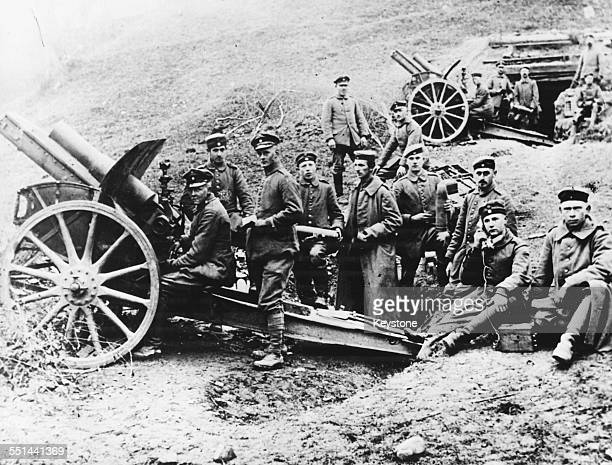 German politician Ludwig Erhard as a young man during World War One acting as a field artilleryman with a group of soldiers near Ypres Belgium circa...