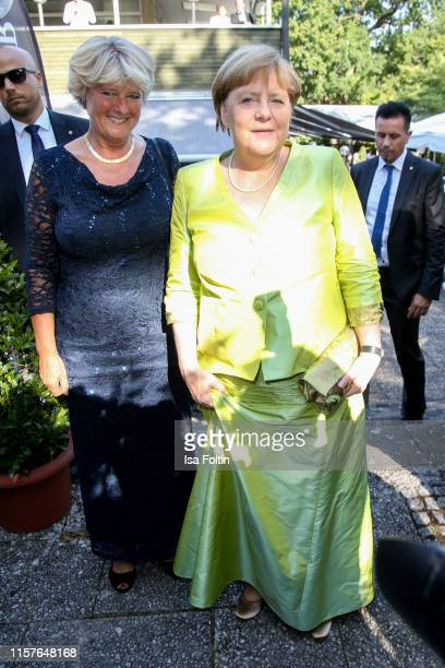 """German politician Monika Gruetters and German Federal Chancellor Angela Merkel during the Bayreuth Festival 2019 opening premiere """"Tannhaeuser"""" at..."""