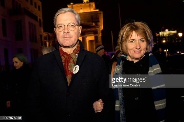 German politician of the Christian Democratic Union Norbert Roettgen and his wife Ebba HerfsRoettgen attend a vigil at the Brandenburg Gate to...