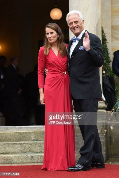 German politician Peter Ramsauer and his wife Susanne arrive at the Festival Theatre on July 25 in Bayreuth southern Germany ahead of the opening of...