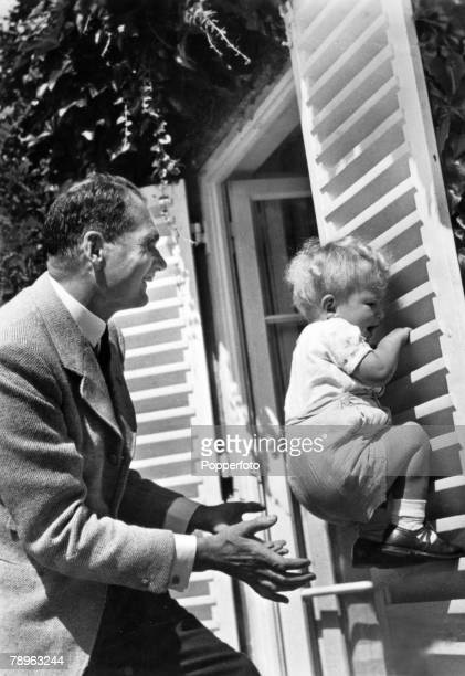 German politician Rudolf Hess playing with his son Wolf Rudiger Hess on the wooden shutters of a house in Germany circa 1940 Rudolf Hess was the...