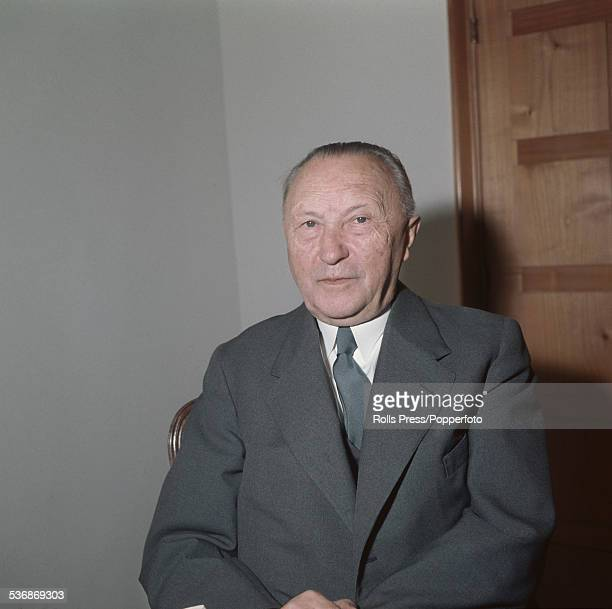 German politician, statesman and Chancellor of West Germany, Konrad Adenauer pictured sitting on a chair circa 1957.
