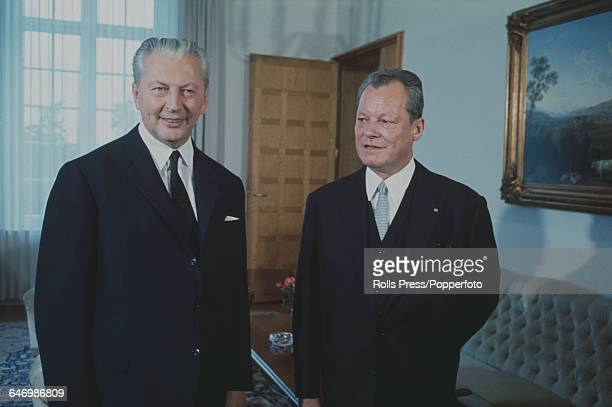 German politicians and successive Chancellors of West Germany Kurt Georg Kiesinger pictured left with Willy Brandt following the 1969 West German...