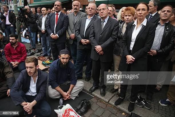 German politicians including Gregor Gysi of Die Linke Petra Pau of die Linke and Yasmin Fahimi of the German Social Democrats join Muslims who had...