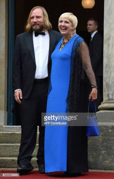 German politicians of Green Party Claudia Roth and Anton Hofreiter arrive at the Festival Theatre on July 25 in Bayreuth, southern Germany, ahead of...