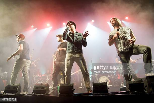 German pop and soul band Soehne Mannheims performs during their 'Wer fuehlen will muss hoeren Tour' at the EWerk on March 11 2014 in Cologne Germany