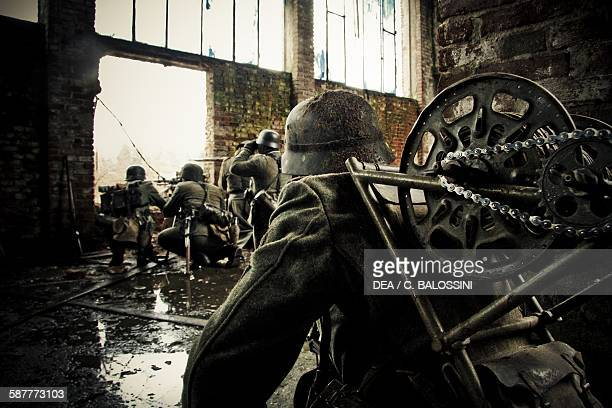 German post with MG42 machine gun defending an abandoned factory with a communications officer in the foreground Stalingrad winter 1943 Second World...