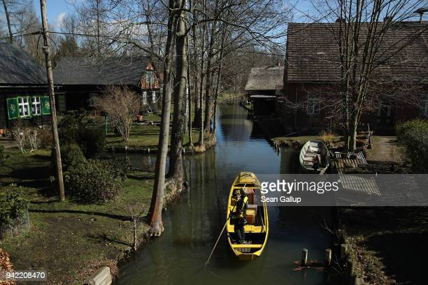 German postal carrier Deutsche Post postal worker Andrea Bunar guides her flat-bottomed canoe as she delivers the mail in the web of canals in the...