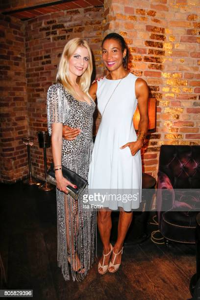 German presenster Tanja Buelter and German presenter Annabelle Mandeng during the host of Annabelle Mandengs Ladies Dinner at Hotel Zoo on July 2...