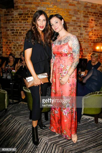 German presenter Alexandra Polzin and German presenter Lina van de Mars during the host of Annabelle Mandengs Ladies Dinner at Hotel Zoo on July 2...