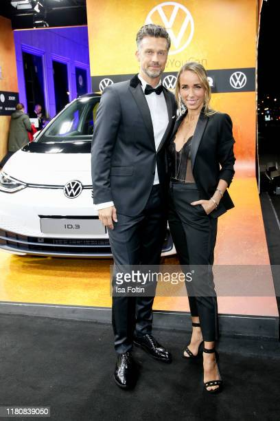 German presenter and actor Wayne Carpendale and his wife German presenter Annemarie Carpendale arrive for the 21st GQ Men of the Year Award at...