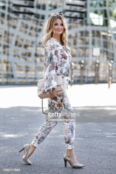 German presenter and TV host Frauke Ludowig wearing a white blouse with multicolored floral print and matching pants by Funky Staff a beige and gold...