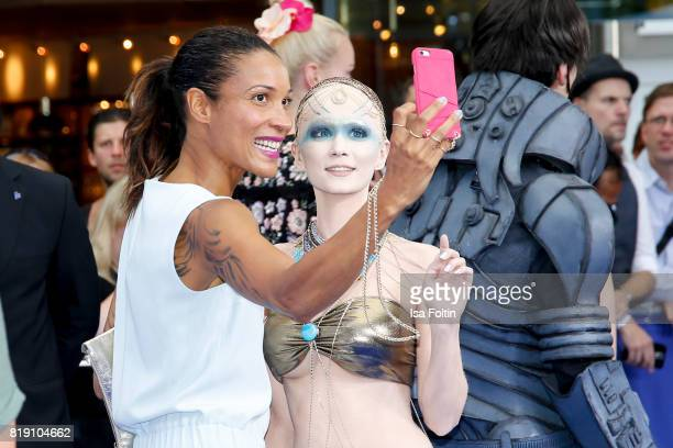 German presenter Annabelle Mandeng with a film figure during the 'Valerian Die Stadt der Tausend Planeten' premiere at CineStar on July 19 2017 in...