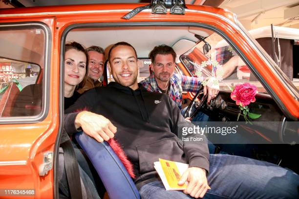 German presenter Bella Lesnik German actor Andre Dietz TV Bachelor Andrej Mangold and German actor Simon Boeer during the Globetrotter celebrates...