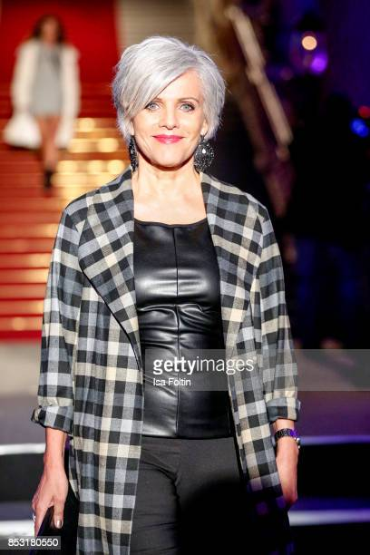 German presenter Birgit Schrowange walks the runway during the Minx Fashion Night in favour of 'Sauti Kuu' of Auma Obama at Wuerzburger Residenz on...