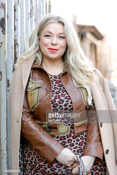German presenter curvy model and plus size influencer wearing a dress with tiger pattern by Asos a brown leather look jacket by Marina Rinaldi a...