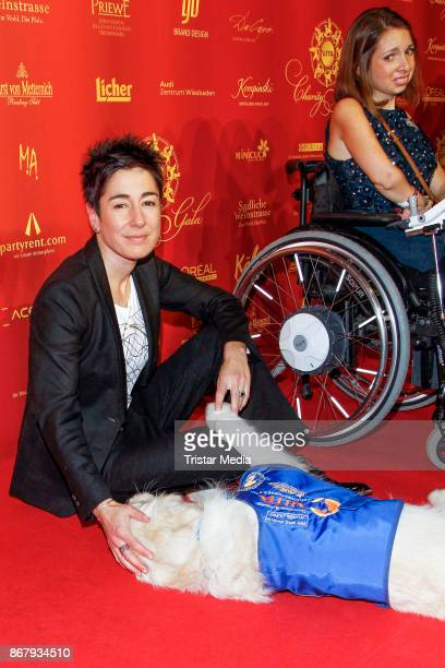 German presenter Dunja Hayali with an assistance dog during the 8th VITA Charity Gala In Wiesbaden on October 28, 2017 in Wiesbaden, Germany.