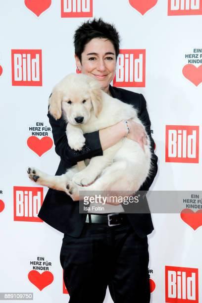 German presenter Dunja Hayali with an assistance dog puppy attends the 'Ein Herz fuer Kinder Gala' at Studio Berlin Adlershof on December 9 2017 in...