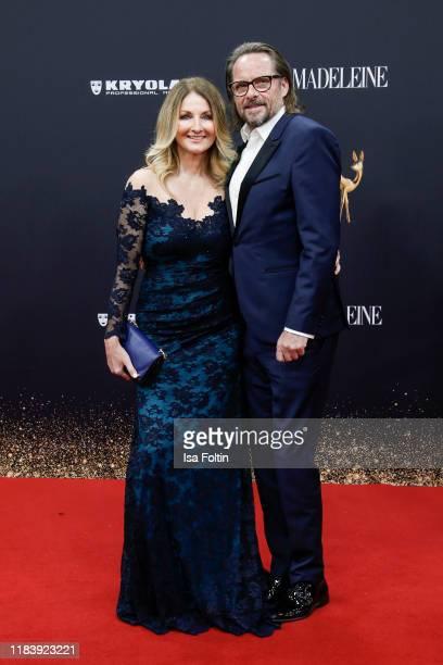German presenter Frauke Ludowig and her husband Kai Roeffen arrive for the 71st Bambi Awards at Festspielhaus BadenBaden on November 21 2019 in...