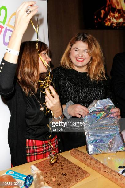 German presenter Jean Bork and German singer Alina Wichmann alias Alina wraps presents for children in need during the Laughing Hearts Charity...