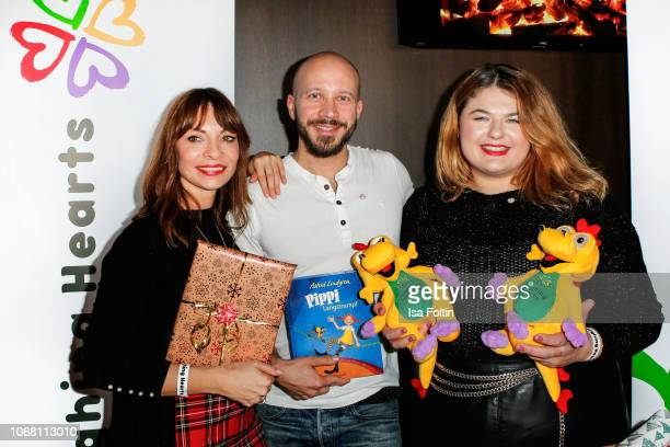 German presenter Jean Bork German actor Max Florian Hoppe and German singer Alina Wichmann alias Alina wrap presents for children in need during the...