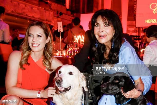 German presenter Jule Goelsdorf and German singer Dunja Rajter with assistance dogs during the 8th VITA Charity Gala on October 28 2017 in Wiesbaden...