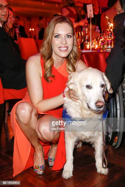German presenter Jule Goelsdorf with an assistance dog during the 8th VITA Charity Gala on October 28 2017 in Wiesbaden Germany