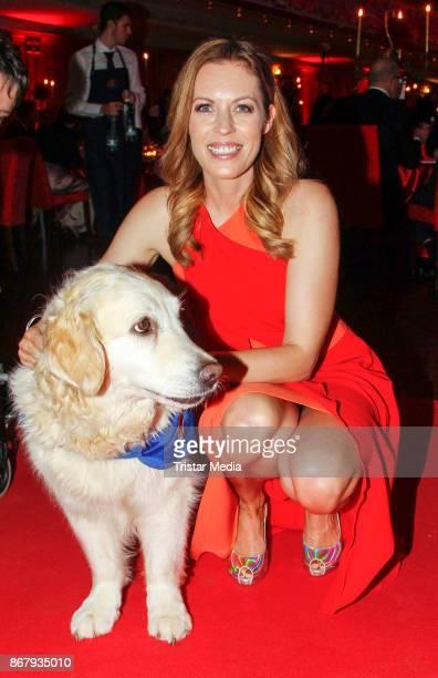 German presenter Jule Goelsdorf with an assistance dog during the 8th VITA Charity Gala In Wiesbaden on October 28 2017 in Wiesbaden Germany