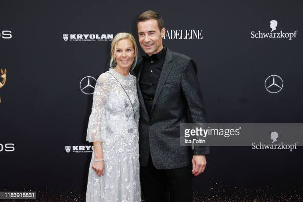German presenter Kai Pflaume and his wife Ilke Pflaume arrive for the 71st Bambi Awards at Festspielhaus BadenBaden on November 21 2019 in BadenBaden...