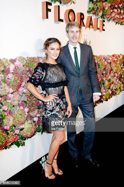 German presenter Nazan Eckes and Triumph owner Roman Braun attend the Florale By Triumph Dinner Hosted By Julianne Moore Dinner at Altes Stadthaus on...