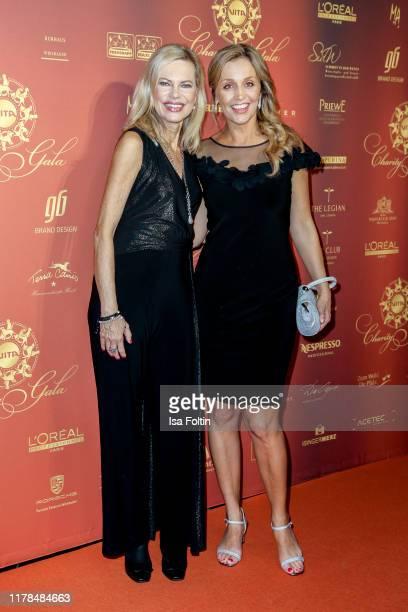 German presenter Nina Ruge and German presenter Sandra Maria Gronewald attend the 10th VITA Charity Gala at Kurhaus Wiesbaden on October 26 2019 in...